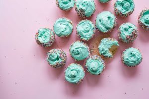 Cupcakes with blue frosting. Photo by Brooke Lark on Unsplash
